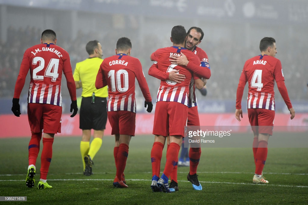 HUESCA, SPAIN - JANUARY 19: Koke of Atletico Madrid celebrates with teammate Diego Godin after scoring his team's third goal during the La Liga match between SD Huesca and Club Atletico de Madrid at Estadio El Alcoraz on January 19, 2019 in Huesca, Spain. (Photo by David Ramos/Getty Images)
