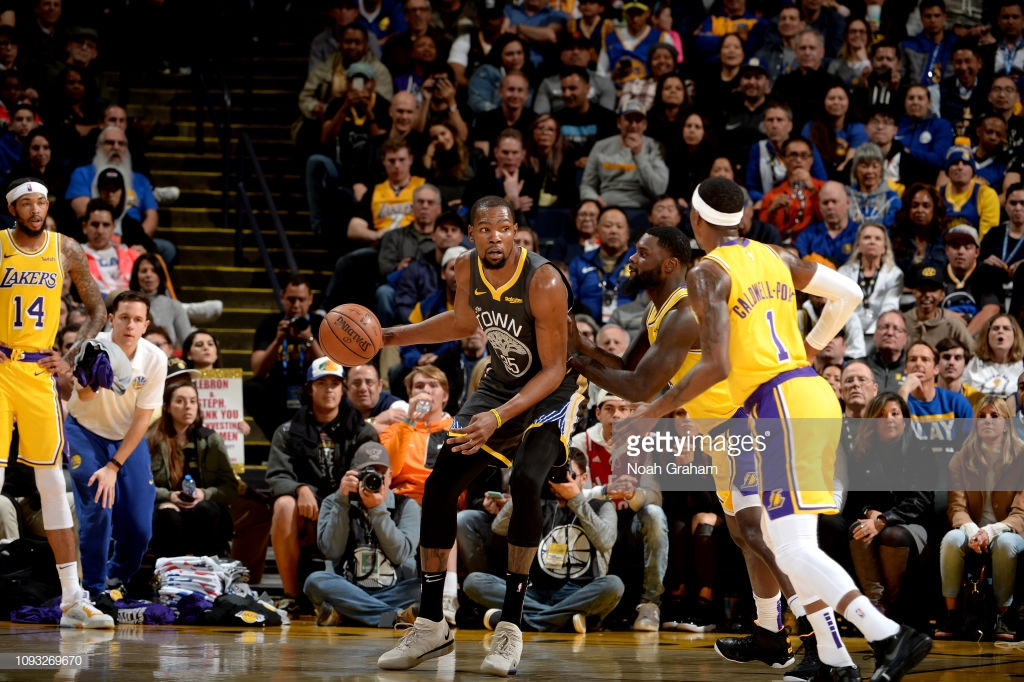 OAKLAND, CA - FEBRUARY 2: Kevin Durant #35 of the Golden State Warriors handles the ball against the Los Angeles Lakers on February 2, 2019 at ORACLE Arena in Oakland, California. NOTE TO USER: User expressly acknowledges and agrees that, by downloading and or using this photograph, User is consenting to the terms and conditions of the Getty Images License Agreement. Mandatory Copyright Notice: Copyright 2019 NBAE (Photo by Noah Graham/NBAE via Getty Images)