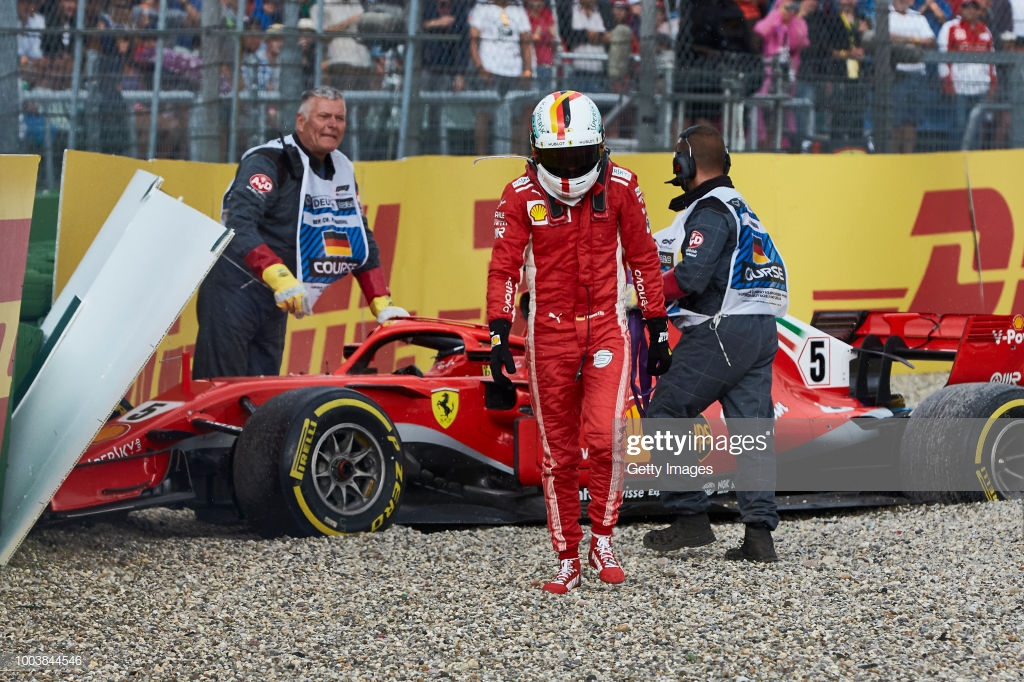 HOCKENHEIM, GERMANY - JULY 22: Sebastian Vettel of Germany and Ferrari walks from his car after crashing during the Formula One Grand Prix of Germany at Hockenheimring on July 22, 2018 in Hockenheim, Germany. (Photo by Getty Images/Getty Images)