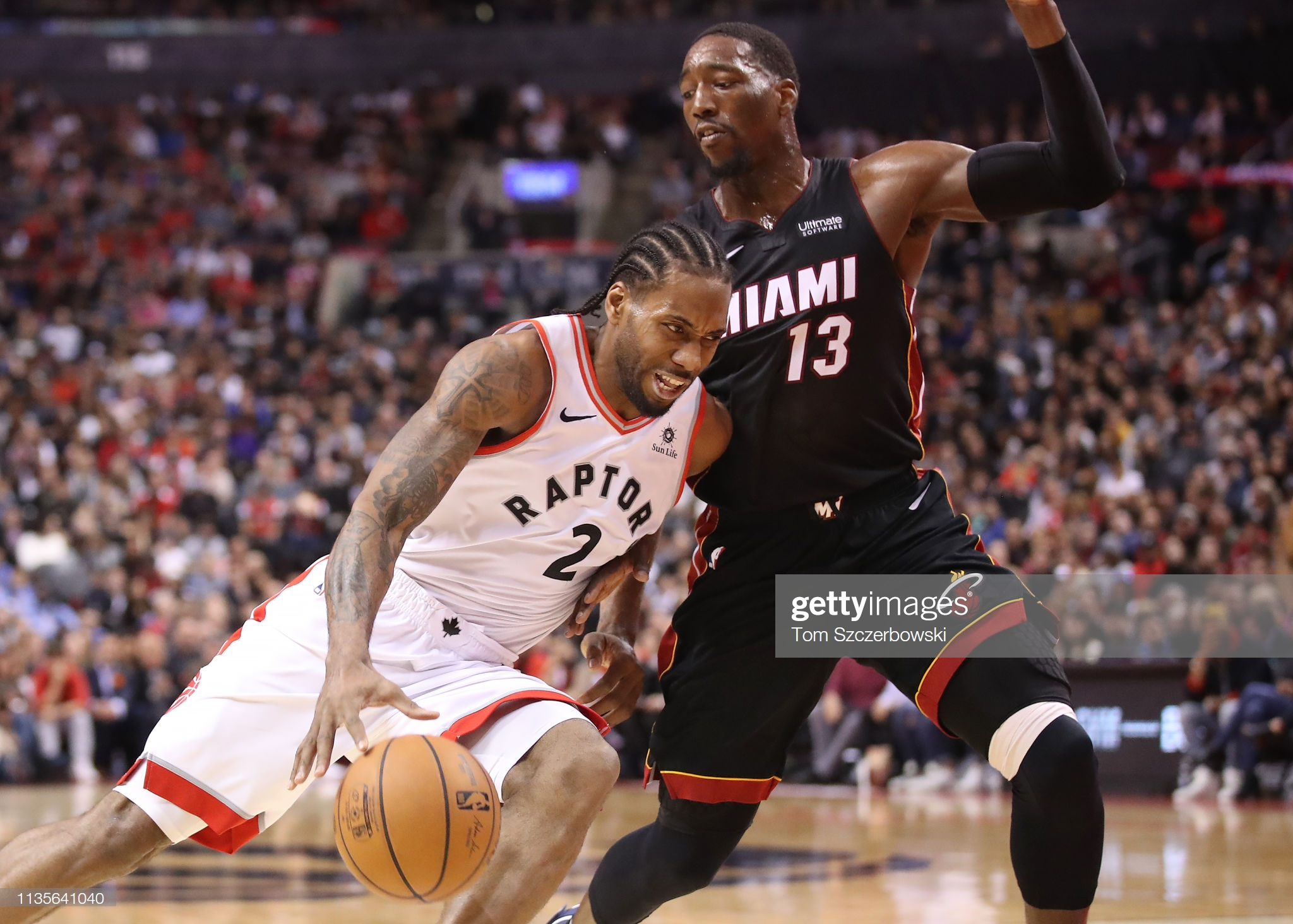 TORONTO, ON - APRIL 07: Kawhi Leonard #2 of the Toronto Raptors drives to the basket in the fourth quarter against Bam Adebayo #13 of the Miami Heat at Scotiabank Arena on April 7, 2019 in Toronto, Canada. NOTE TO USER: User expressly acknowledges and agrees that, by downloading and or using this photograph, User is consenting to the terms and conditions of the Getty Images License Agreement. (Photo by Tom Szczerbowski/Getty Images)