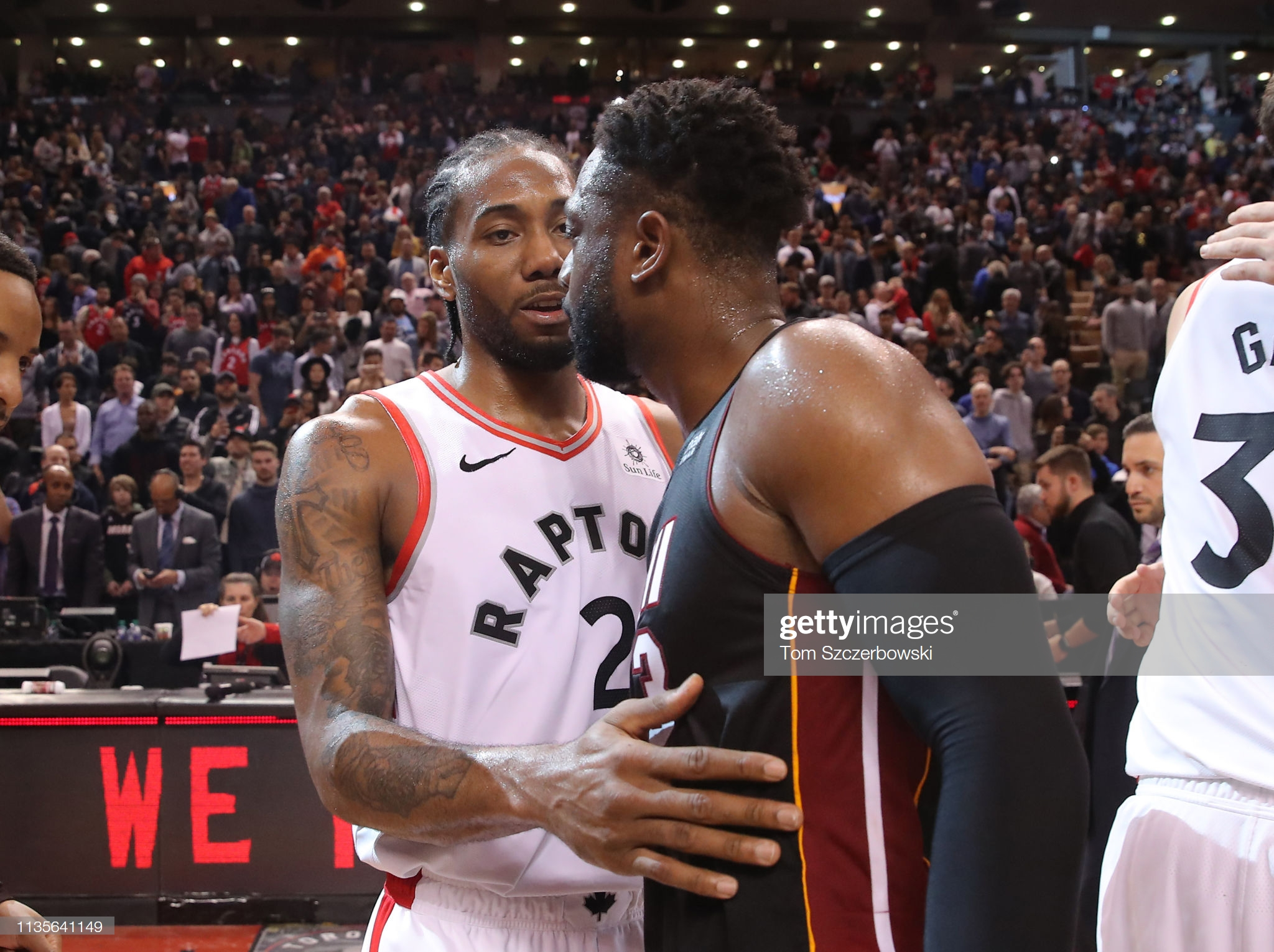 TORONTO, ON - APRIL 07: Dwyane Wade #3 of the Miami Heat is congratulated by Kawhi Leonard #3 of the Toronto Raptors following their NBA game as Wade plans to retire at the end of the season this week at Scotiabank Arena on April 7, 2019 in Toronto, Canada. NOTE TO USER: User expressly acknowledges and agrees that, by downloading and or using this photograph, User is consenting to the terms and conditions of the Getty Images License Agreement. (Photo by Tom Szczerbowski/Getty Images)