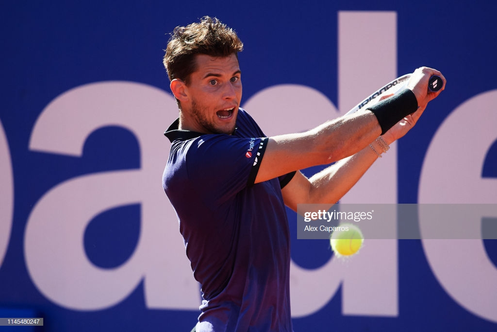 BARCELONA, SPAIN - APRIL 27: Dominic Thiem of Austria plays a backhand against Rafael Nadal of Spain during their semifinal match during day six of the Barcelona Open Banc Sabadell at Real Club De Tenis Barcelona on April 27, 2019 in Barcelona, Spain. (Photo by Alex Caparros/Getty Images)